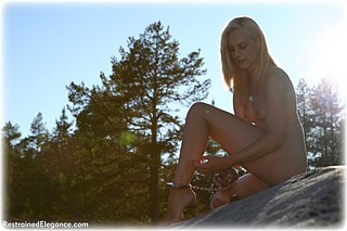 Bondage photo pic picture Ariel Anderssen barefoot, handcuffs, self bondage, shackles, leg irons, metal bondage, nude, outdoor, ungagged
