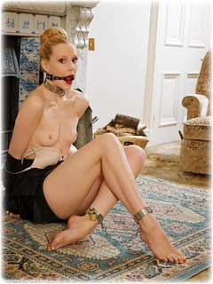 Bondage photo pic picture Ariel Anderssen barefoot, satin, blonde, shackles, blouse, silk, skirt, slave training, leg irons, lingerie, metal bondage, nude, collar, pencil skirt, ungagged, ring gag