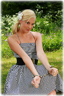 Bondage photo pic picture Ariel Anderssen ballgown, barefoot, handcuffs, humiliation, leg irons, metal bondage, outdoor