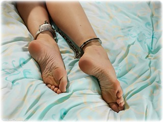 Bondage photo pic picture Ariel Anderssen barefoot, bedroom, handcuffs, blonde, hogtie, leg irons, metal bondage, nude, ungagged