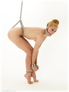 Bondage photo pic picture Ariel Anderssen ballgag, barefoot, shackles, chains, metal bondage, collar, nude, ungagged