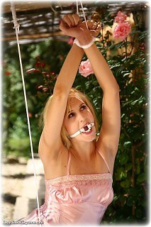 Bondage photo pic picture Ariel Anderssen ring gag, satin, silk, stockings, outdoor