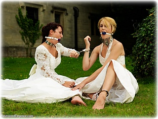 Bondage photo pic picture Ariel Anderssen and Sammie B ballgag, girlgirl, ballgown, barefoot, handcuffs, satin, leg irons, chains, metal bondage, collar, outdoor