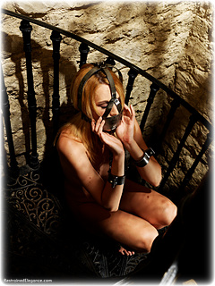Bondage photo pic picture Ariel Anderssen barefoot, scolds bridle, shackles, leg irons, chains, medieval, metal bondage, collar, nipple clamps, nude