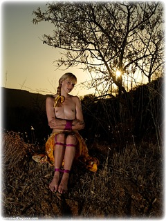 Bondage photo pic picture Ariel Anderssen barefoot, rope bondage, skirt, outdoor, topless, ungagged