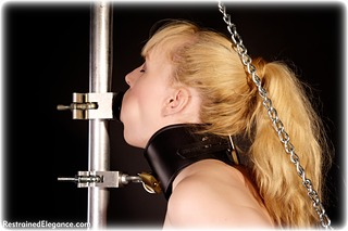Bondage photo pic picture Ariel Anderssen gag, barefoot, blonde, shackles, bondage pole, latex, chains, metal bondage, nude, collar, topless