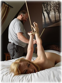 Bondage photo pic picture Ariel Anderssen rope bondage, barefoot, bedroom, blonde, melodrama, strappado, comedy, corporal punishment, nude, paddle, ungagged