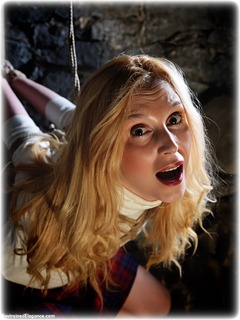 Bondage photo pic picture Ariel Anderssen barefoot, blonde, skirt, cloth gag, strappado, sweater, dungeon, ungagged, rope bondage