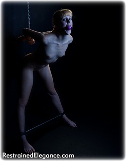 Bondage photo pic picture Ariel Anderssen barefoot, chains, spreader bar, metal bondage, strappado, nude, ballgag, ungagged