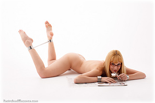 Bondage photo pic picture Ariel Anderssen ballgag, barefoot, shoes, spreader bar, metal bondage, nude, glasses