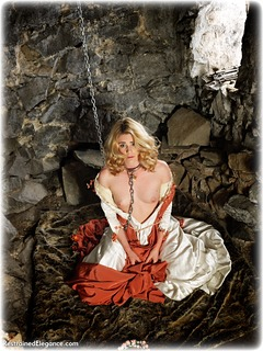 Bondage photo pic picture Artemis Fauna barefoot, gown, blonde, humiliation, chains, medieval, metal bondage, collar, dungeon, topless, ungagged