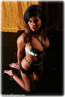 Bondage photo pic picture Ashley W ballgag, barefoot, handcuffs, leg irons, chains, lingerie, metal bondage, ungagged