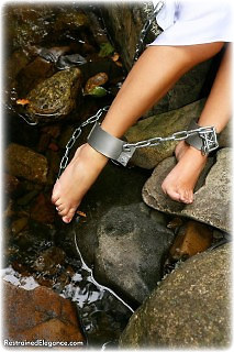 Bondage photo pic picture Belle barefoot, satin, shackles, leg irons, chains, metal bondage, collar, outdoor