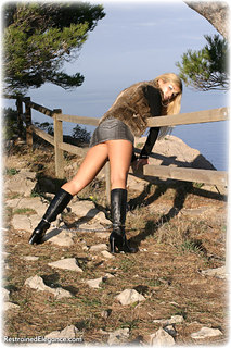 Bondage photo pic picture Belle handcuffs, boots, skirt, leg irons, metal bondage, outdoor