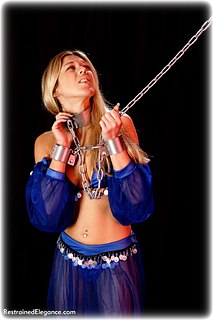 Bondage photo pic picture Belle barefoot, harem, shackles, silk, leg irons, chains, cloth gag, metal bondage, collar