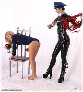 Bondage photo pic picture Industrial Bitch and Belle handcuffs, barefoot, humiliation, lesbian, metal bondage, corporal punishment, uniform, whipping, girlgirl