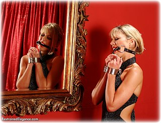 Bondage photo pic picture Belle ballgown, barefoot, handcuffs, bit gag, humiliation, leg irons, metal bondage, nude