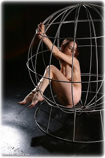 Bondage photo pic picture Bianca barefoot, handcuffs, shackles, cage, metal bondage, nude