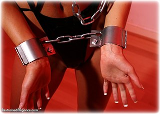 Bondage photo pic picture Candice Simmons barefoot, shackles, leg irons, chains, lingerie, metal bondage, collar