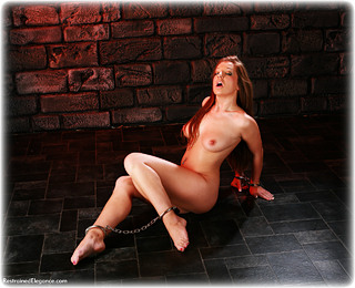 Bondage photo pic picture Cate Harrington barefoot, handcuffs, leg irons, metal bondage