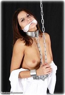 Bondage photo pic picture Charisma Cole barefoot, shackles, leg irons, cloth gag, medieval, metal bondage, topless