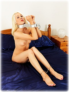 Bondage photo pic picture Charlotte Elizabeth barefoot, handcuffs, leg irons, metal bondage, nude, ungagged, fiddle