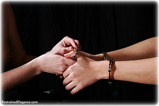 Bondage photo pic picture Charlotte Gee and Faith girlgirl, barefoot, handcuffs, humiliation, leg irons, lesbian, metal bondage, nude