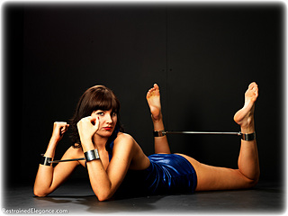 Bondage photo pic picture Chloe James barefoot, gown, spreader bar, metal bondage, dress