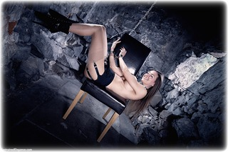 Bondage photo pic picture Claire Topaz shackles, boots, brunette, sm factory, leg irons, chains, lingerie, stockings, metal bondage, collar, suspension, dungeon, topless, ungagged