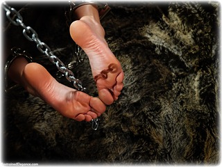 Bondage photo pic picture Claire Topaz romance, barefoot, handcuffs, single glove, brunette, leg irons, chains, metal bondage, dress, dungeon, ungagged, leather bondage