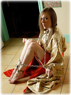 Bondage photo pic picture Cobie barefoot, satin, shackles, silk, brunette, sm factory, leg irons, chinese dress, spreader bar, metal bondage, collar, ungagged