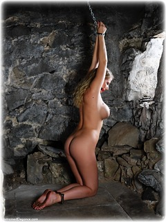 Bondage photo pic picture Danielle Maye ballgag, barefoot, handcuffs, blonde, leg irons, chains, metal bondage, nude, dungeon, ungagged