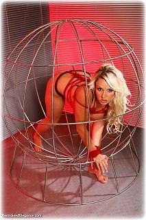 Bondage photo pic picture Dannii Harwood shackles, cage, leg irons, chains, lingerie, stockings, metal bondage, topless