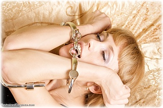 Bondage photo pic picture Delta barefoot, handcuffs, silk, leg irons, cloth gag, metal bondage