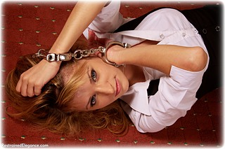 Bondage photo pic picture Dolly barefoot, handcuffs, business wear, leg irons, cloth gag, metal bondage, ungagged