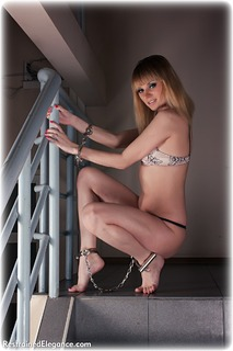 Bondage photo pic picture Dolly barefoot, handcuffs, leg irons, lingerie, metal bondage