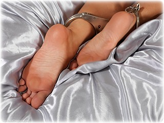 Bondage photo pic picture Elle barefoot, bedroom, shackles, leg irons, metal bondage, collar, nude, ungagged