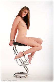 Bondage photo pic picture Elle Tyler barefoot, handcuffs, leg irons, chains, metal bondage, nude