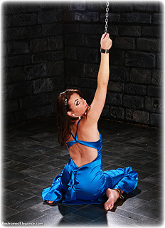 Bondage photo pic picture Elle Tyler ballgown, barefoot, humiliation, shackles, leg irons, slave training, chains, collar, nude