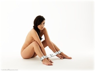 Bondage photo pic picture Faye barefoot, brunette, cloth gag, metal bondage, collar, nude, ungagged
