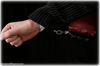 Bondage photo pic picture Fi Stevens handcuffs, blouse, humiliation, topless
