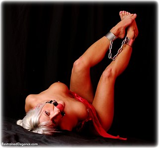 Bondage photo pic picture Francesca Lee ballgag, barefoot, shackles, leg irons, metal bondage