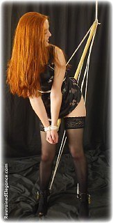 Bondage photo pic picture Gemma Craven bit gag, cane, chinese dress, leather bondage, rope bondage, satin, silk, spreader bar, stockings