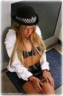 Bondage photo pic picture Hannah barefoot, handcuffs, leg irons, topless, uniform