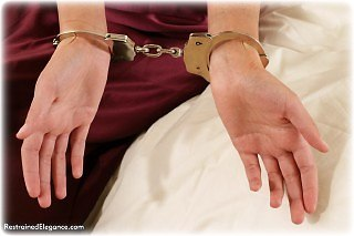 Bondage photo pic picture Jasmine N ballgown, handcuffs, leg irons, metal bondage, satin, shoes, silk