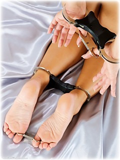 Bondage photo pic picture Jenni C barefoot, satin, bedroom, handcuffs, hogtie, leg irons, chains, metal bondage, nude, ungagged