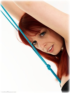 Bondage photo pic picture Temptress Kate rope bondage, shackles, sm factory, leg irons, spreader bar, lingerie, stockings, metal bondage, collar, crotch rope, predicament, ungagged, redhead, ring gag