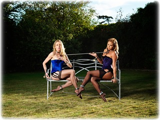 Bondage photo pic picture Natalia Forrest and Katy Cee girlgirl, satin, bit gag, blonde, shackles, shoes, brunette, sm factory, leg irons, lesbian, lingerie, spreader bar, stockings, collar, corset, outdoor, ungagged