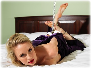 Bondage photo pic picture Katy Cee barefoot, satin, bedroom, handcuffs, self bondage, blonde, hogtie, silk, leg irons, chains, metal bondage, nightwear, topless, ungagged
