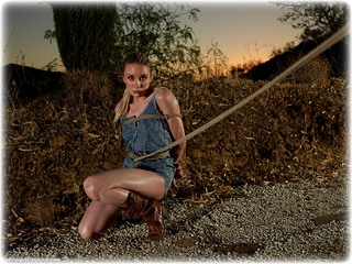 Bondage photo pic picture Katy Cee humiliation, boots, jeans, slave training, outdoor, crotch rope, topless, ungagged, rope bondage